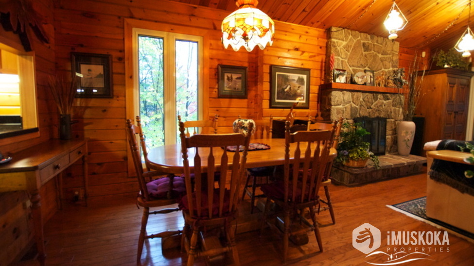 Dining Room Pine log and warm and cozy Muskoka feel.