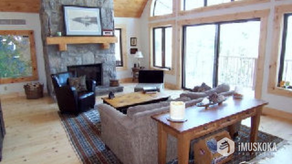 Stone Fireplace Muskoka stone fireplace with pine flooring living room