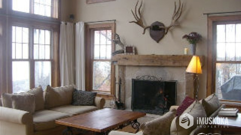 Beautiful fireplace and wood floors Beautiful fireplace with antler dressing.