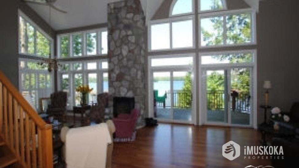 Living Area, hardwood floors Windows illuminate the living room.