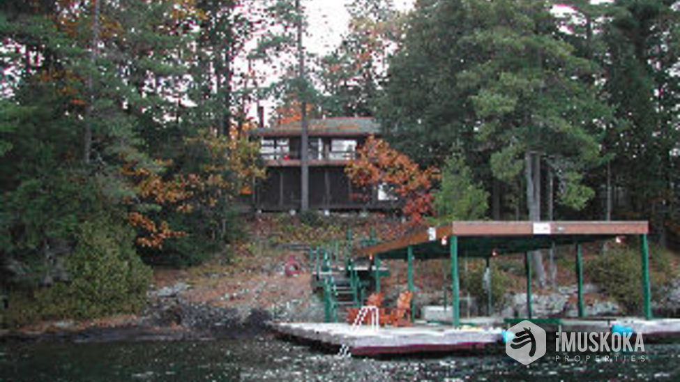 View From Water View of cottage from lake in a boat