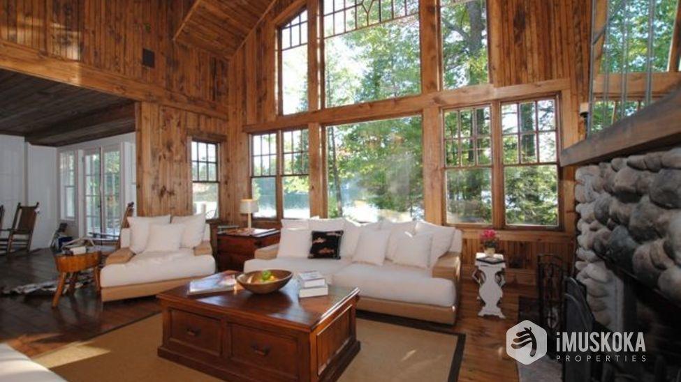 Elegant and Comforting River rock Muskoka fireplace