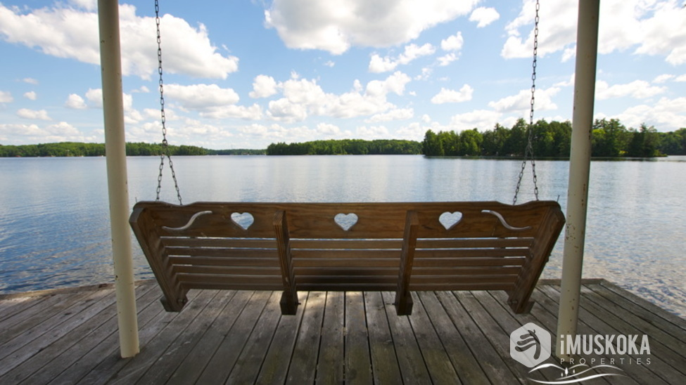 Tranquil Views calming swing at the waters edge boathouse.